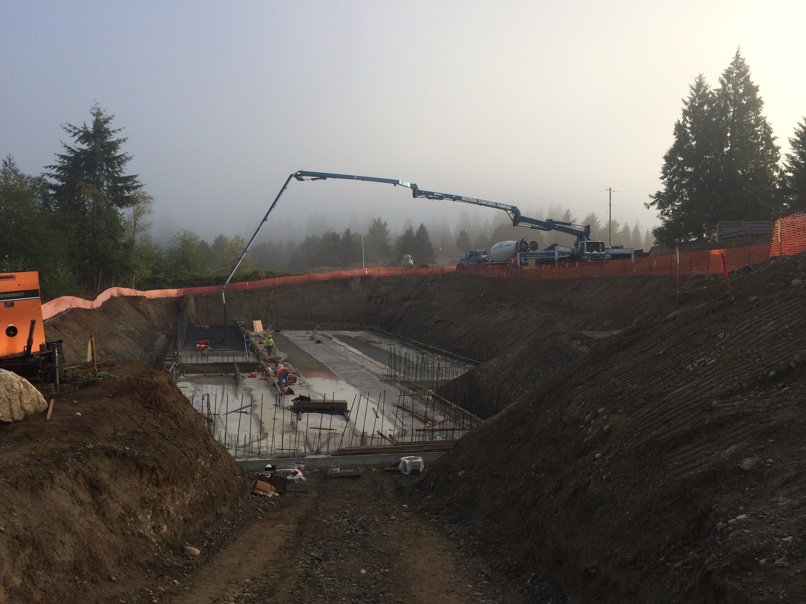47M Boom pouring a footing in King County, WA.
